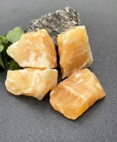 Calcite, yellow Rough pieces 500gr / fp Large pack